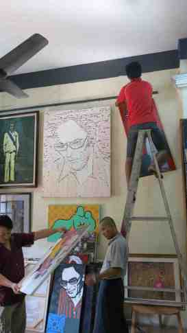 Hanging the Bagyi Aung Soe exhibition at Pansodan