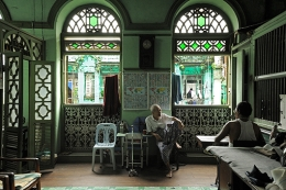 U Khin Sein in the second floor lounge with his protégé, Aung San. The former tailor has lived here six decades